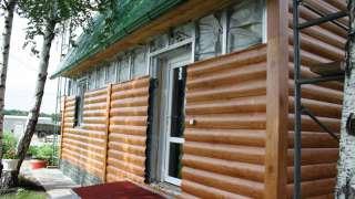 Обшивка дома деревянным сайдингом